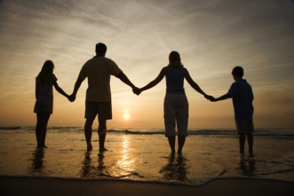 A family holding hands