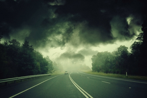 A road going into a storm.