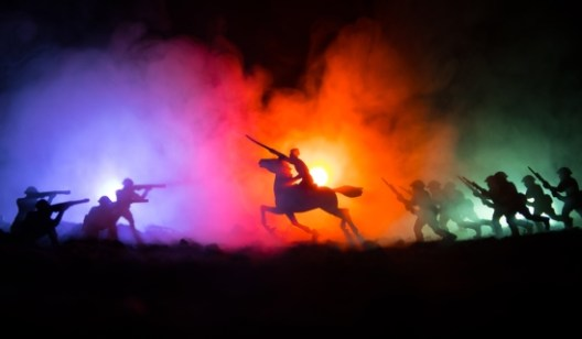 Man on horseback riding into battle - Dreamstime_108256905
