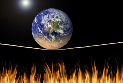 World on tightrope over flames.