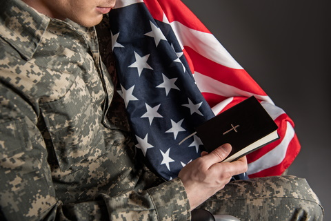 American Soldier with Flag and Bible - Dreamstime-109632626