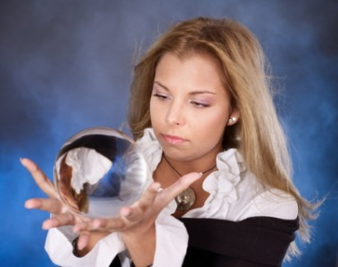 Woman casting spell with Crystal Ball - Dreamstime-16388395