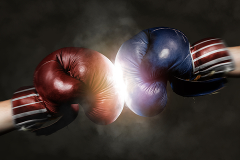 Republicans and Democrats in the campaign symbolized with Boxing gloves