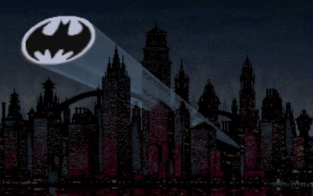 The Batsignal Over Gotham's skyline.