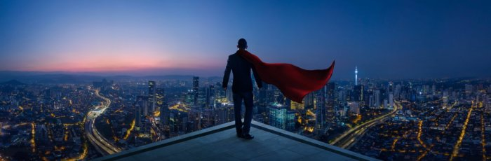 Superhero on roof - Dreamstime-111070697