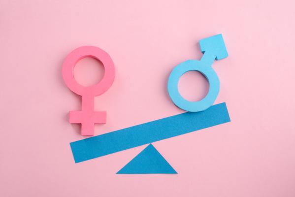 Women over men on a balance