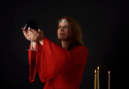 Neo-pagan priestess in red robes.
