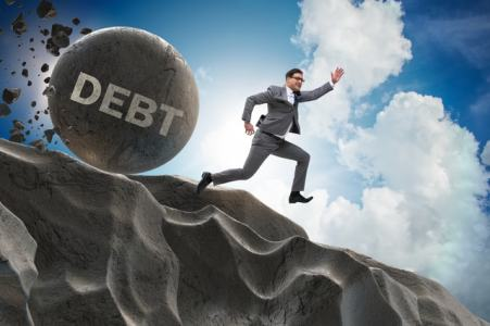 Rolling debt ball - Dreamstime-100300880