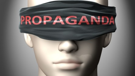 Man with eyes covered by propaganda - AdobeStock-320705180