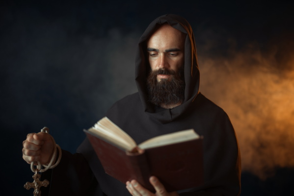 Black robed priest - AdobeStock - 256071432