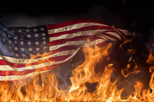 Burning American flag. AdobeStock - 85253922.