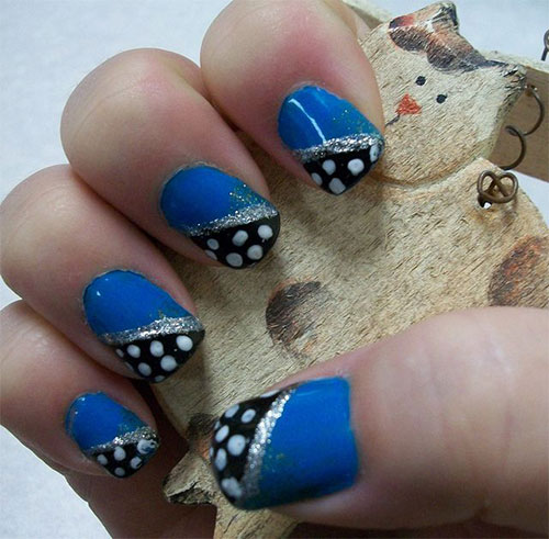 Blue Nails With Black Feather And Dreamcatcher Nail Art