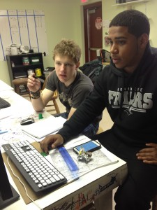 Pat, FabNewport intern, showing Julio, of Met School Providence, the ins and outs of OpenSCAD.