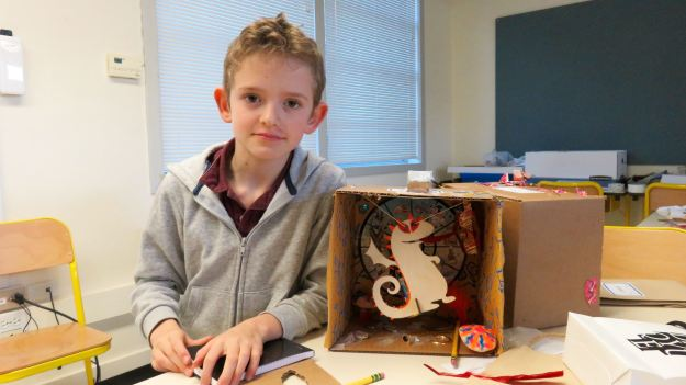 Young art maker Theodore Carman built a cardboard propeller to move his flying dragon for the Chinese New Year Wonderbox he is making at the Lycée Français.
