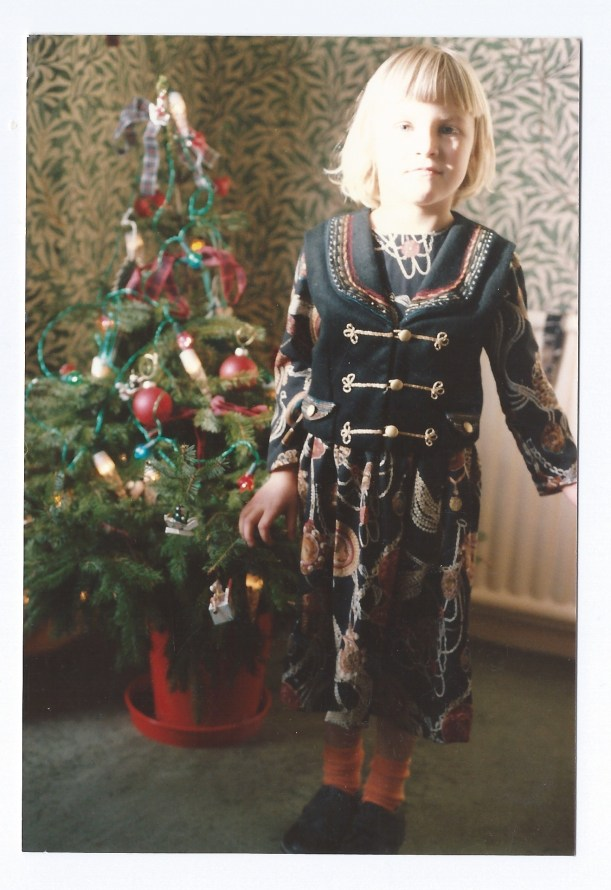 Esme wearing ablackdress and embroidered waistcoat c1990