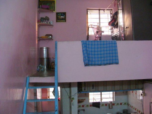 Interior of Mumbai flat with pink walls and blue ladder steps