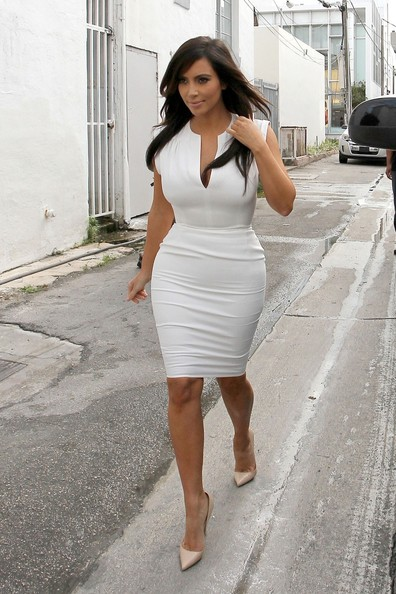 Kim Kardashian in tight white mini dress