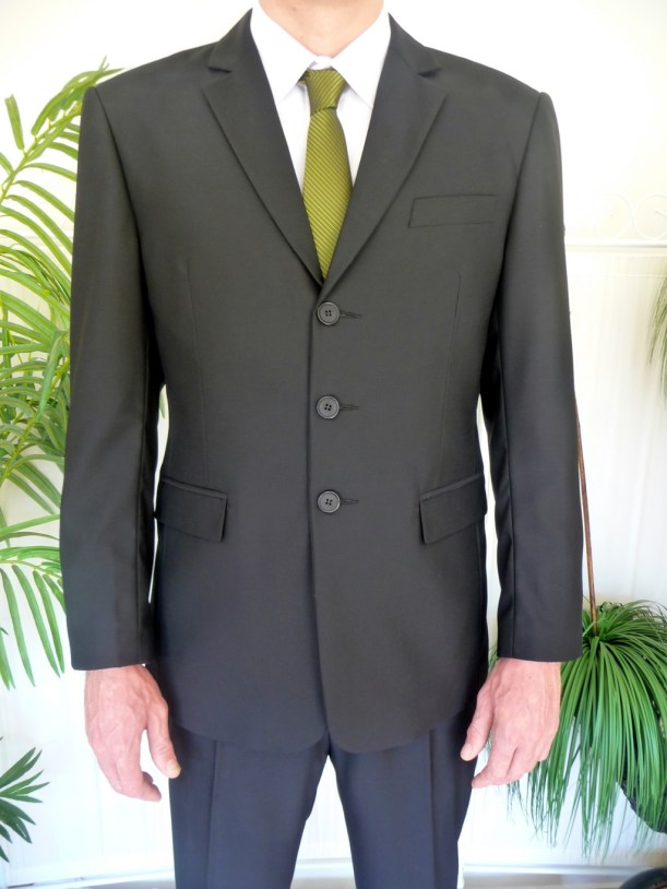 Grey suit with three buttons done up
