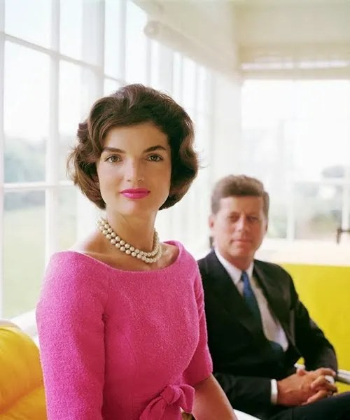 JK in Pink dress and Pearls. With JFK