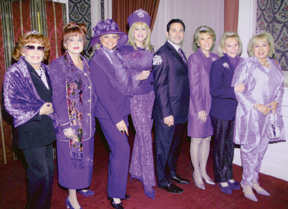 five women dressed in purple
