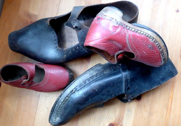 Black adult clogs and red children's clogs