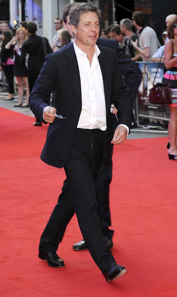 Hugh Grant, suit and no tie