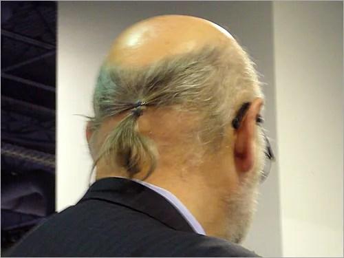 bald man, pony tail