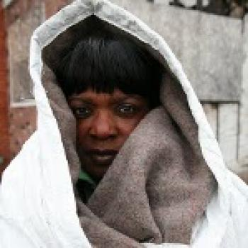 Homeless woman in the coat