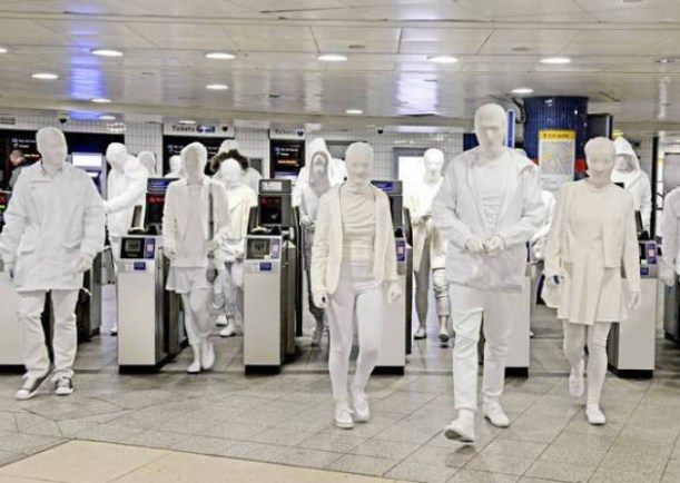 Tube travellers in white