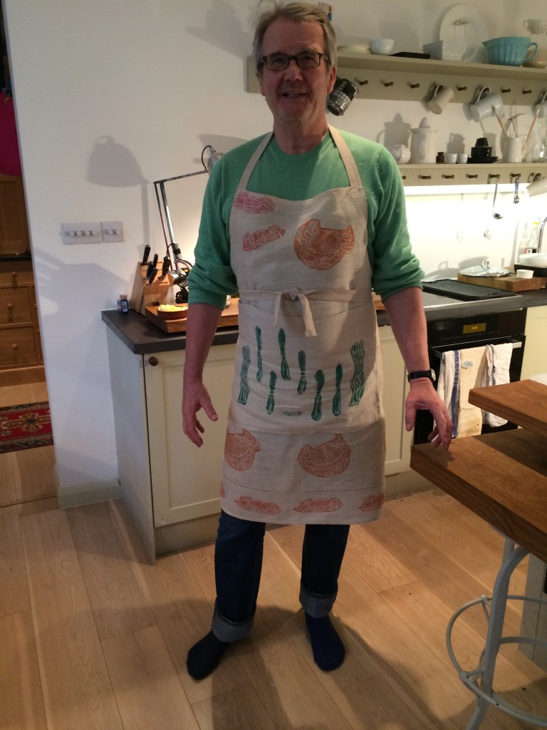 Man in hand printed apron