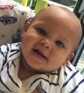 Smiling, teething baby