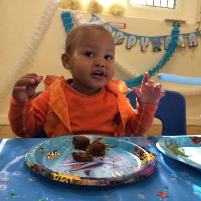 Goldfish boy enjoys the cake