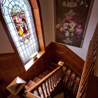 Stairs with stained glass window