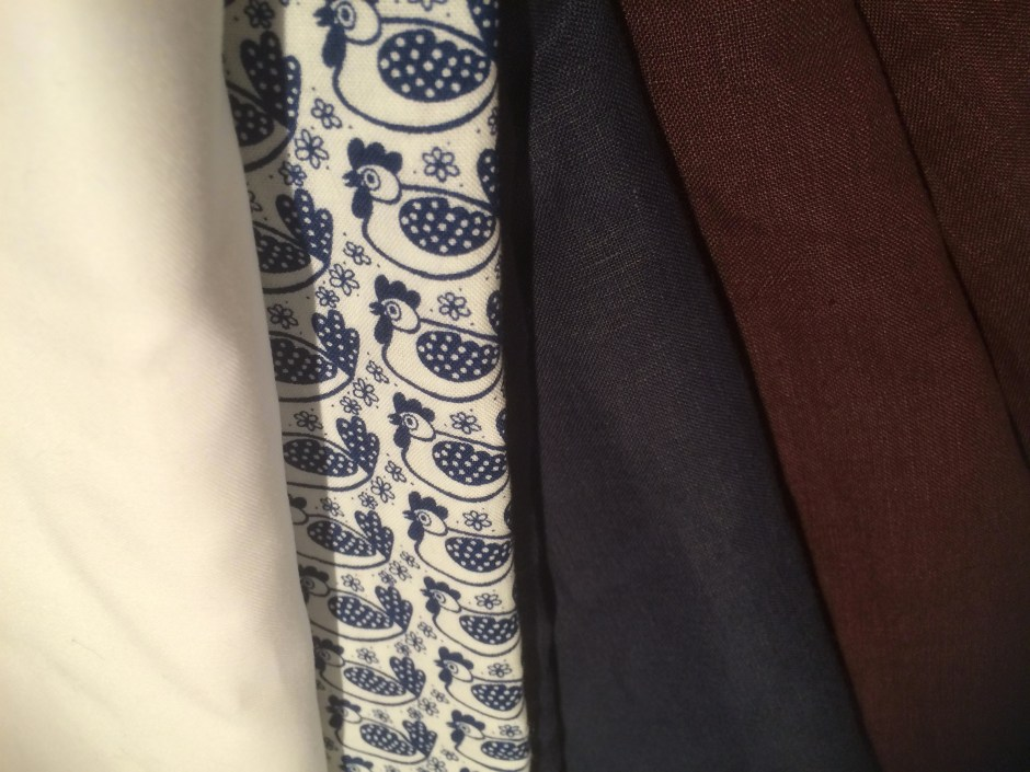 navy, white, maroon and patterned fabric