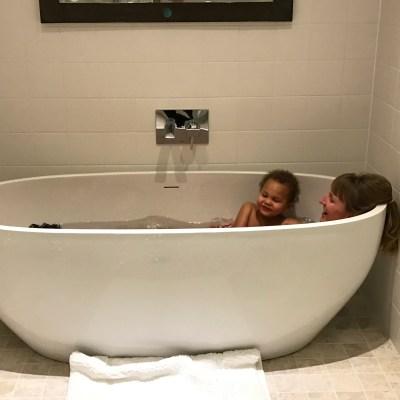 Master bathroom with three bathers)