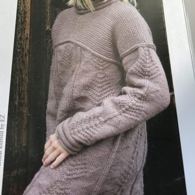 Knitted by Betsy Wyeth including Quaker stitch, applied I cord on yoke an a Guernsey motif on the body and sleeve