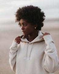 Woman wearing Morcant hooded sweatshirt on beach