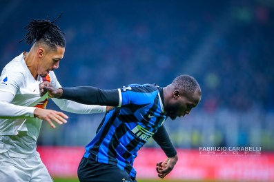 Chris Smalling of AS Roma and Romelu Lukaku of FC Internazionale during the Serie A match between FC Internazionale and AS Roma at the San Siro Satdium, Milan, Italy on 06 December 2019. Photo Fabrizio Carabelli