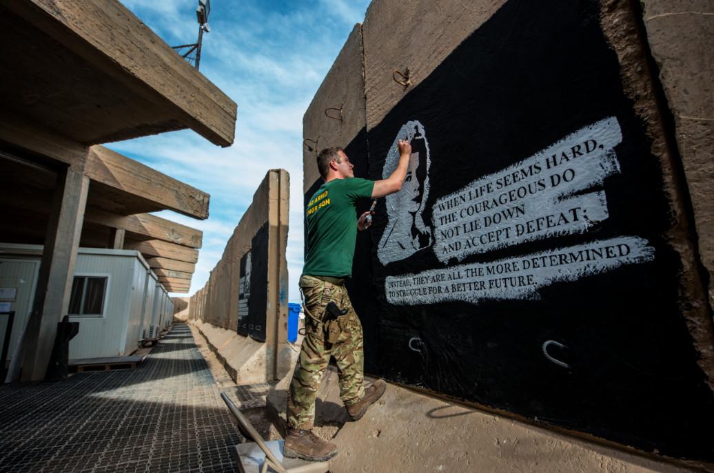 Cpl Nick Johns, Photographer, Sapper Adam Williams Painting A Blast Wall, Camp Taji, Iraq, On Operation Shader 3, April 2016. © Nick Johns.