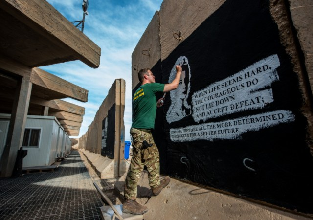 Cpl Nick Johns, Photographer, Sapper Adam Williams Painting A Blast Wall, Camp Taji, Iraq, On Operation Shader 3, April 2016. © Nick Johns.