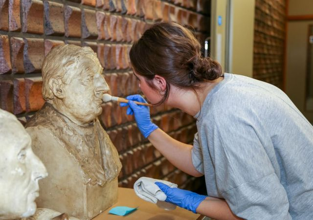 Conservator charlotte hanmore cleans sculptures at the beecroft gallery © the artist's estate. photo, art uk alt 2