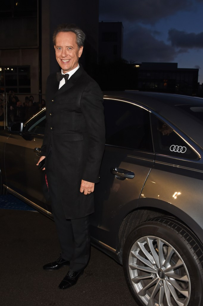 Richard e. grant arrives in an audi at the ee british academy film awards at the royal albert hall, london, sunday 10 february 2019