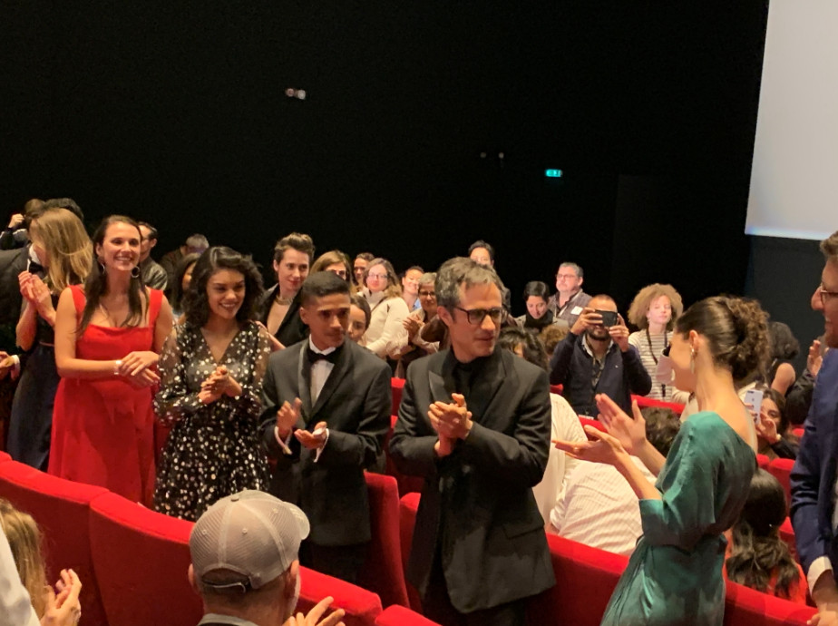 Bernal, with glasses, and emmanuel, to his left, at the screening of 'chicuarotes'