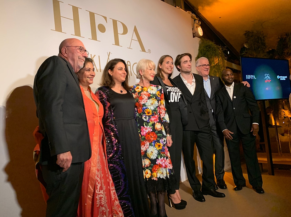 The HFPA cocktail event with Helen Mirren in centre and Robert Pattison to her left