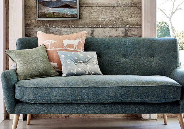 Style sofa with plants patterned pillows