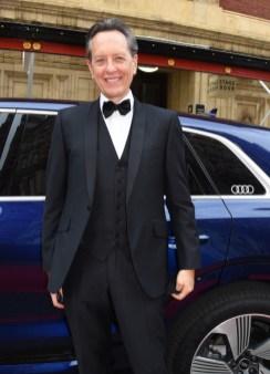 Richard e. grant arrives in an audi at the ee british academy film awards 2021 at royal albert hall, london, sunday 11 april 2021