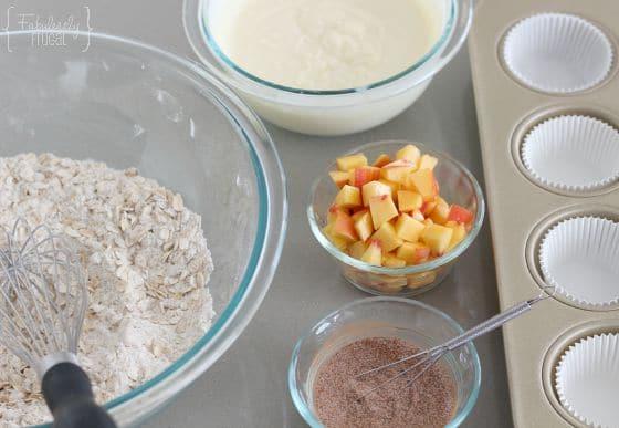 peach oatmeal muffins with fresh peaches