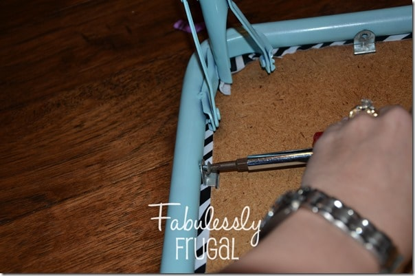 Screwing folding table back together
