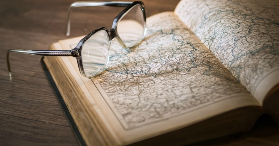 Pair of glasses on a map