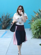 480x640-21395b3400d9-assets-elleuk-com-gallery-24687-2015-01-06-dakota-fanning-out-and-about-in-la-getty-jpg